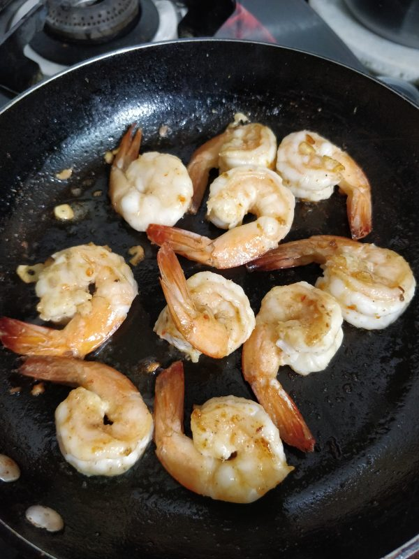 cooking prawns on pan